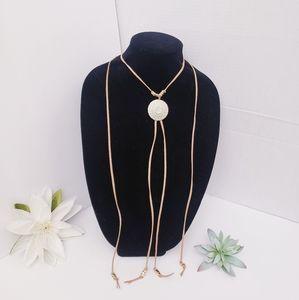 Boho cream suede cord w/distressed brass pendant
